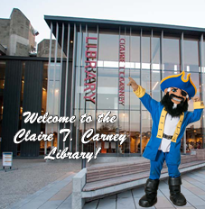 Arnie, UMassD Mascot, Welcomes You At Entrance to the Carney Library