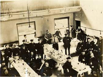 New Bedford police headquarters hosting out of town police during the strike, July 30,1928. About 500 police were called in to help from Boston and elsewhere. This photograph shows the arrangements made to feed them while off duty.