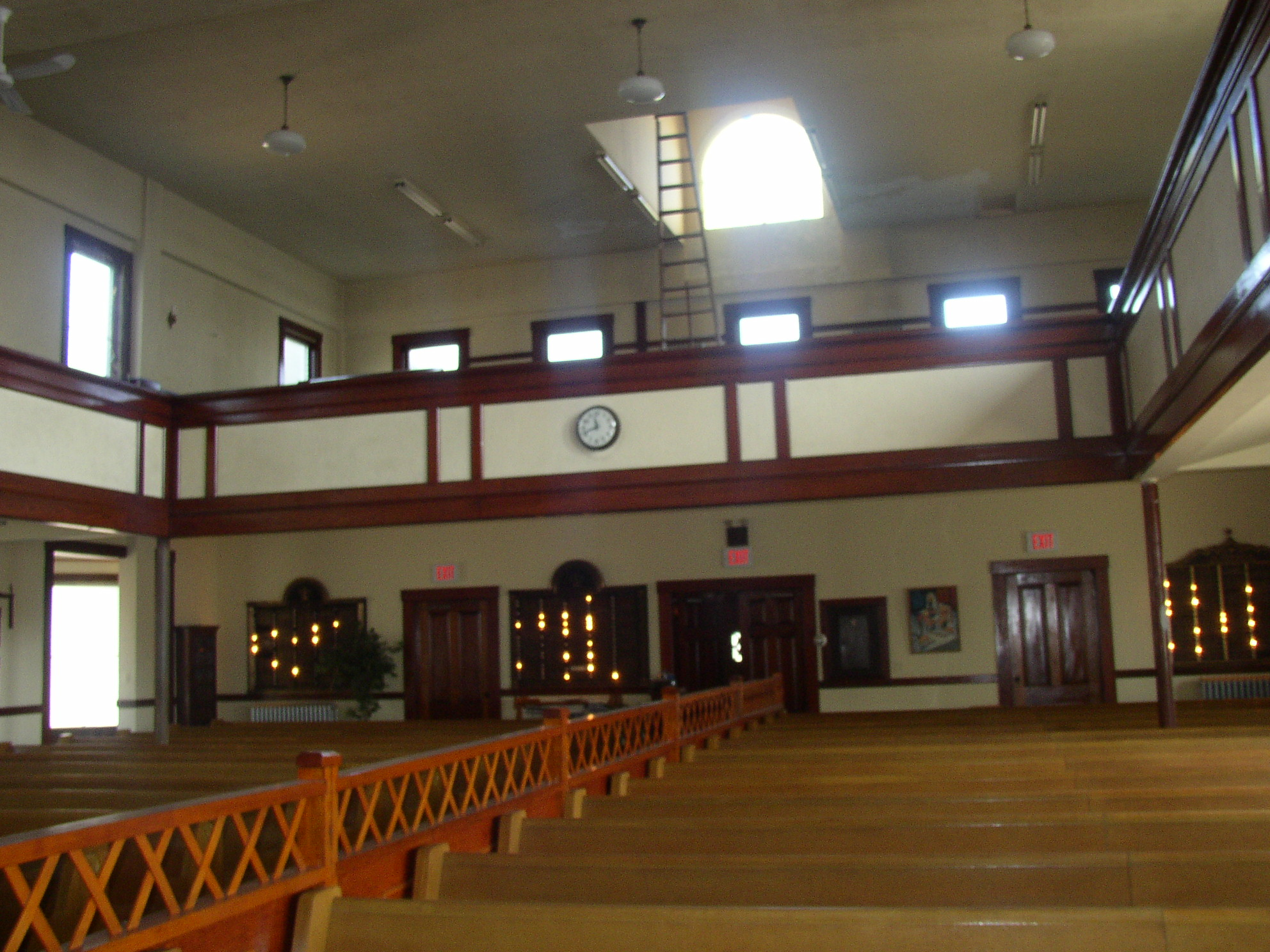 View of the interior of the synagogue showing the center railing which separates the men from the women for worship, as is Orthodox custom