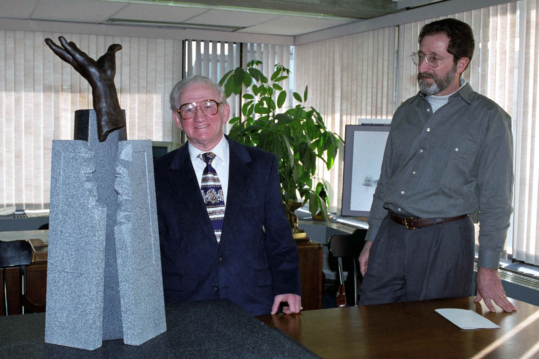 Abe Landau, left, and Peter London, right, with a scale model of the memorial.