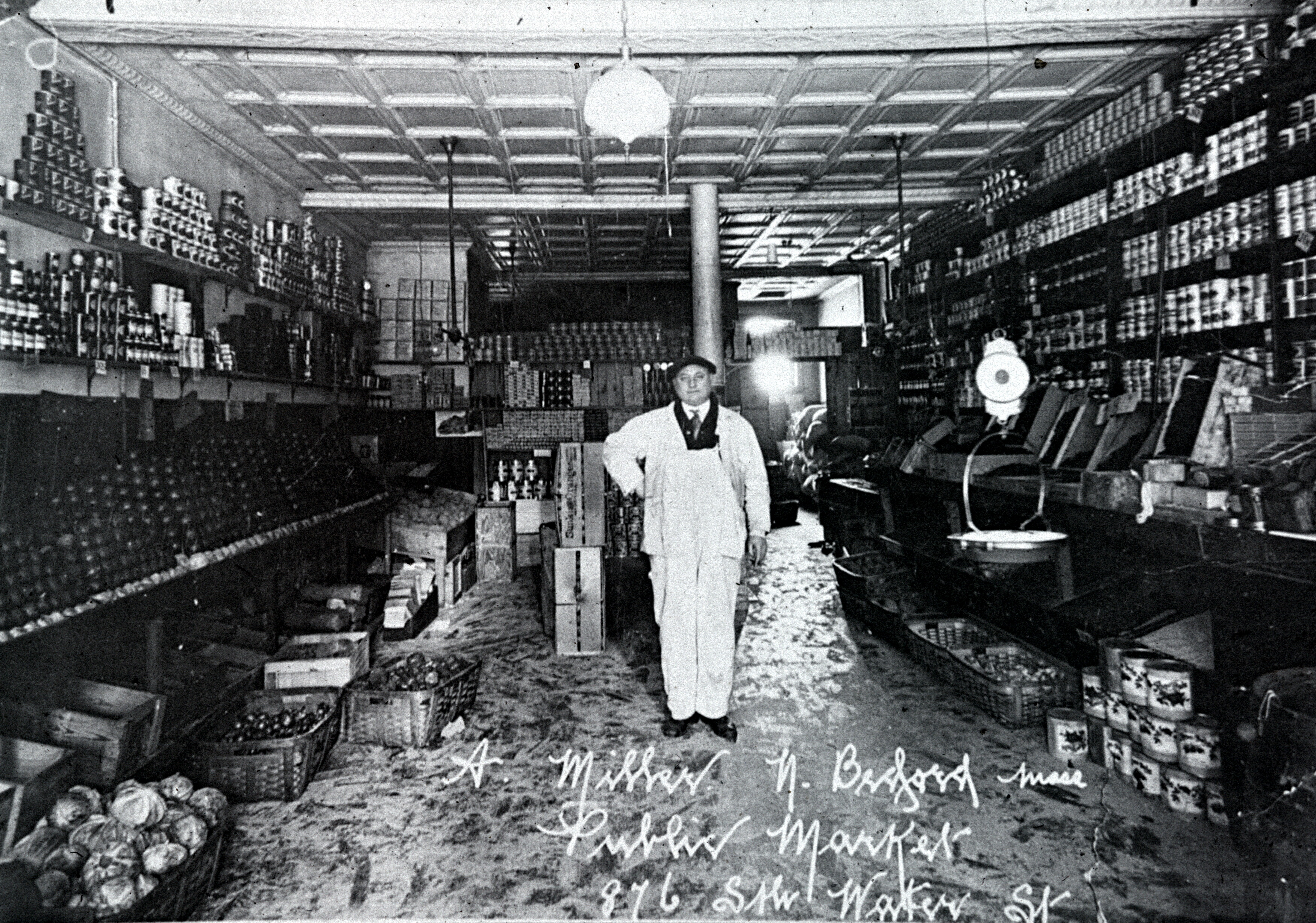 Hyman Miller in his store in the public market at 876 South Water Street