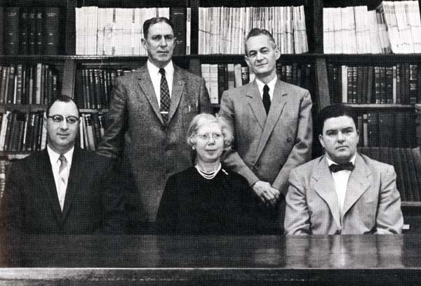 Helen Eaton, center,           seated, here pictured in the 1958 yearbook with fellow department of           Social Sciences, Languages, and Business Administration professors (seated,           left to right) William Wild, Walter Cass,(standing, left to right) Rudolf           Lavault, and Frederick Winter.