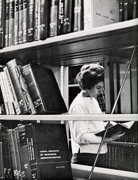 A picture of Helen Eaton browsing some books at the library