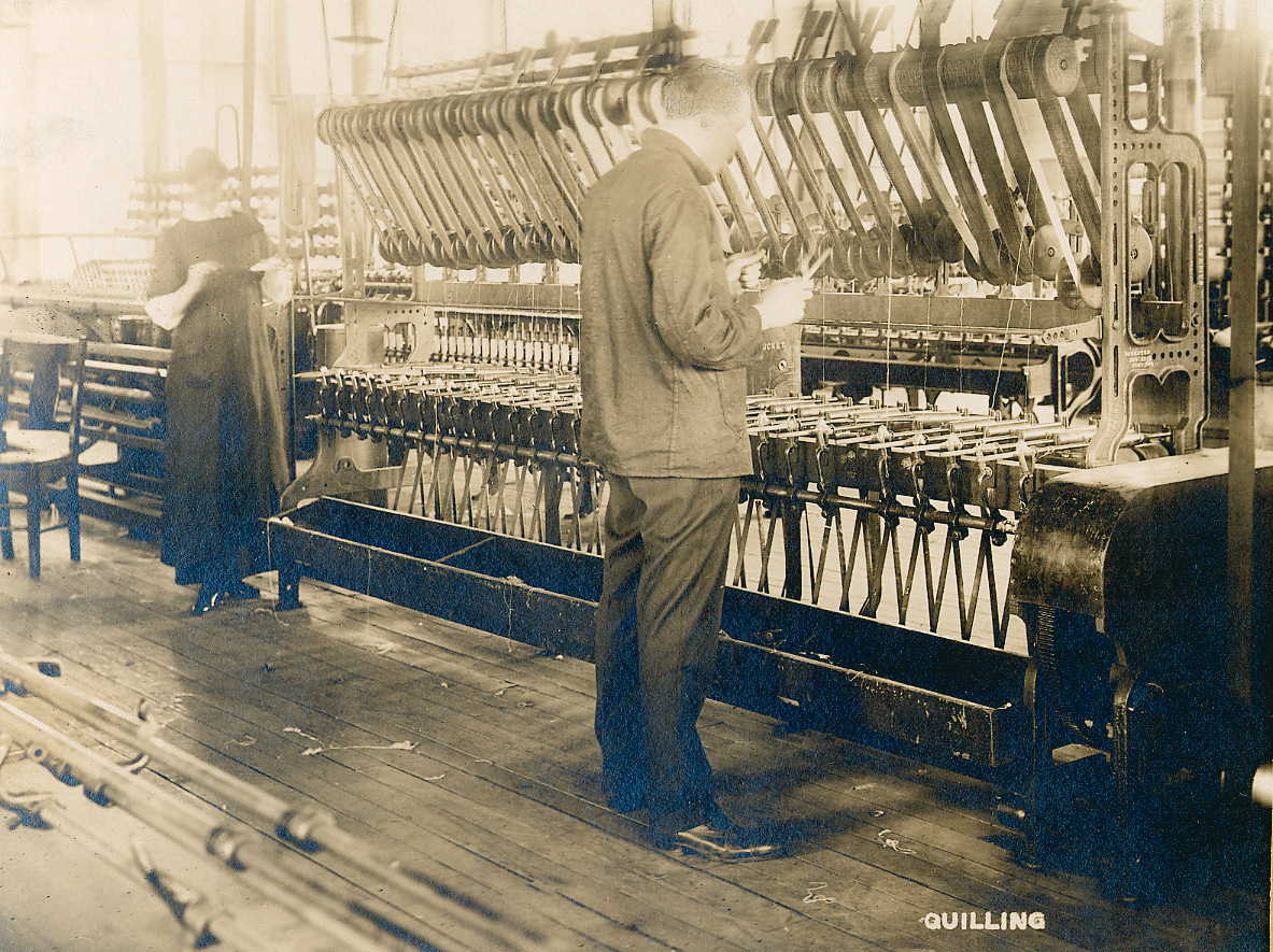 1913 photo of students at work quilling. Bradford Durfee Textile School